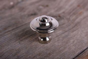 Deze retro knop past goed op een jaren vijftig en jaren zestig meubel