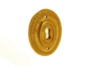 Klassieke sleutelplaat ovaal brons antiek voor meubelen 53mm verticaal.