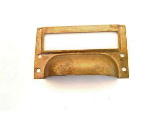 Etikettengreep brons antiek 75mm dun