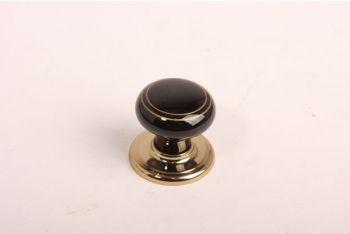 Knop zwart porselein 35mm met goudkleurige randen en een voetje